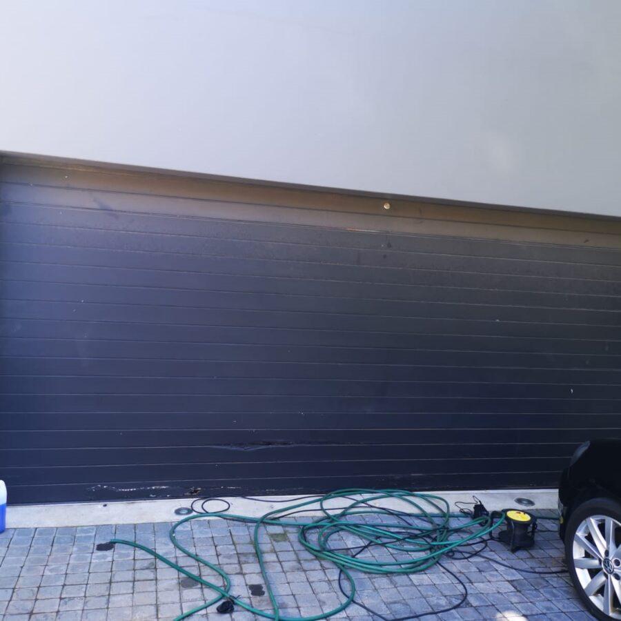 Broken garage door panels that need to be repaired - GP Garage Door Repair Fourways.jpg