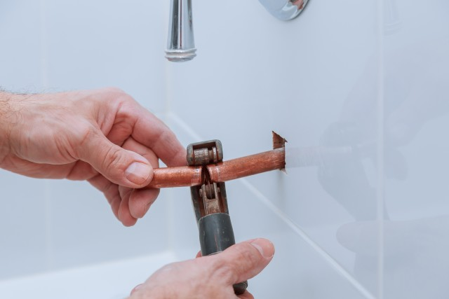 copper pipe cutting in bathroom Plumbers Network.jpg