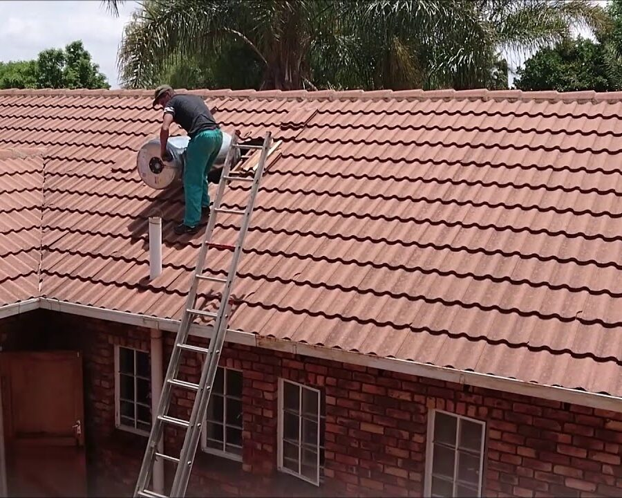 Geyser Experts Removing Geyser From The Roof.jpg